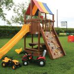 Outside Play Paddock, with ride ons,, swings and a tower slide