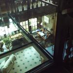 """1st floor, looking down to breakfast area, note the glass """"walk of faith"""" on left"""