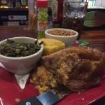 Stuffed Porkchop, cornbread, collards, peas and rice. $10.00.  Best meal in town at any price!