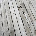 Broken boardwalk by cabin