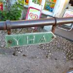 Vintage YHA sign attached to the bridge over Malham Beck.