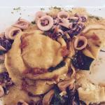 Fantastic home made fish tortelli with calamari sauce