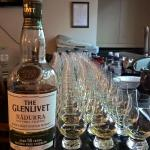 Line up of whiskies poured ready to be handed out
