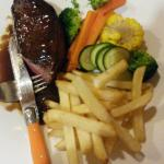 Rump steak medium, chips and vegetables, pepper sauce