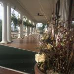 Gracious Veranda with rocking chairs, music and libations