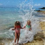 the girls splashing on the beach