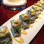 Bad avocados on sushi roll.