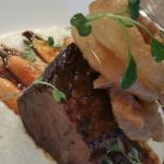 Apple cider braised short rib over stone ground white grits with cheddar with crispy IPA battere