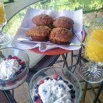 Breakfast muffins, berries in cream, and orange juice