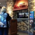 Jane waiting to get seated at Swiss Chalet.