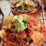 traditional nachos and blue crab nachos