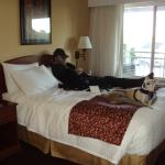 Husband and chuk taking a nap on bed.