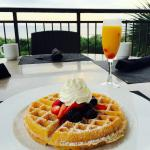 Belgian Waffle with Macerated Berries and Whipped Cream (Mimosa to drink)