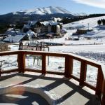 Relax in the hot tub and watch skiers go by