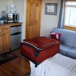 The kitchenette living area. Sorry about the luggage! Had a nice tv with cable but we didn't wat