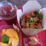 lucky fortune tea, chicken asian rice bowl, and mango slices on the side