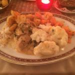Main course, pork in mushroom sauce with crispy potatoes, cauliflower cheese and carrots in hone