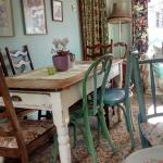 The smaller dining room at Café Violette is elegantly eclectic in its decor and furnishings.