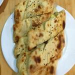 part of vegetarian banquet: generous pide filled with melted cheese and potatoes