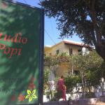 Studio Popi sign and the house