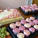 Cupcakes, fruit platter and large birthday cake.