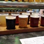 Flight of beers from Sand Creek Brewing Co