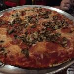 Thin crust pizza with pepperoni and mushroom