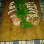 Chicken Breast Wrapper with Parma Ham and filled with Mozzarella and Sundried Tomatoes.