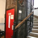 Elevator & spiral staircase to apartments