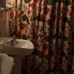 wash basin with lovely curtains drawn