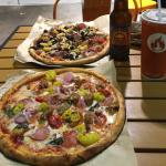 Two custom pizzas, a beer, and a soft drink for $25