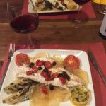 Fish of the day (sea bass) baked with tomatoes, olives, radicchio, & potatoes with a local Pinot