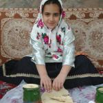 A girl eating Dizi