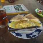 breakfast : omelette, tea and fresh fruit