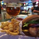 Bacon cheeseburger with curl fries and a Samuel Adams $16,44