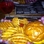 Classic burger with waffle fries & glass of rosè
