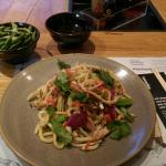 Ginger chicken on udon noodles with chilli and garlic edamame.
