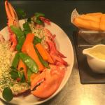 Our Whole Grilled Lobster with Triple cooked chips, seasonal vegetables and lemon butter sauce.