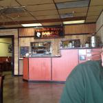 Diner is located in a strip mall that has seen better days. Delicious bar-b-que! Order at the co