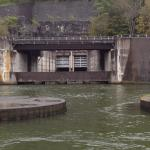 Dam with pumped storage area at top of the mountain. Release gates below.