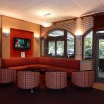 Coin salon télé à côté du Bar de l'Hôtel Ibis Centre
