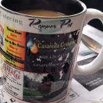 The fun mugs advertise local businesses