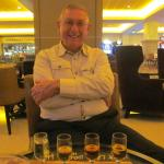 My husband loving his flight of Scotch before the meal