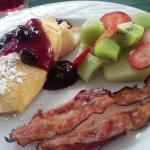 Breakfast day one - peaches and cream filled crepe, bacon and fruit