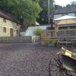 View of courtyard and hot tub looking towards Miller's Cottage