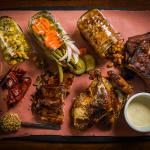 BBQ Sample Platter for 2 or 4 includes smoked half chicken, rack of ribs,chopped brisket, farmer