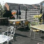 Terrace seating at Poachers Brasserie