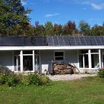 South side of house with the solar photovoltaic panels on the roof