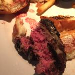 Hamburger ordered medium. It came raw on the inside, and burned on the outside. Blood was drippe