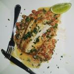 Mahi Mahi over rice with garlic butter sauce, cilantro, chorizo sausage and a twist of lime!